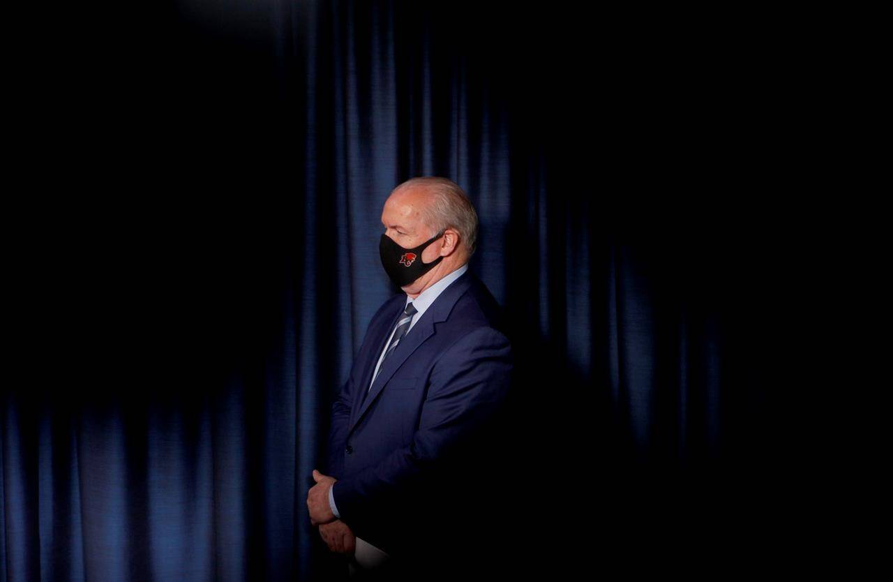 Premier John Horgan looks on during a press conference at the Legislature in Victoria, Monday, March 1, 2021. THE CANADIAN PRESS/Chad Hipolito