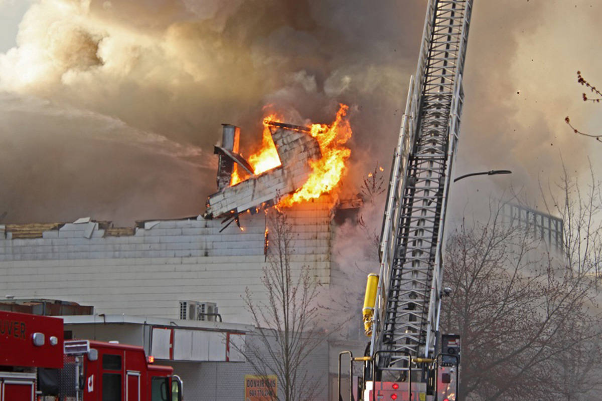 Fire crews battle a blaze at the Duke of Connaught Lodge No. 64 (North Vancouver Masonic Centre) in North Vancouver on Tuesday, March 30, 2021. (Shane MacKichan)