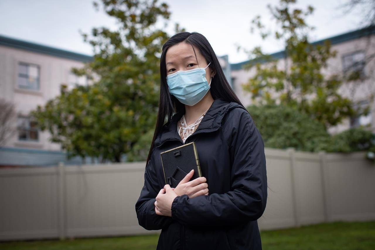 Bernadette Cheung poses for a photograph outside Little Mountain Place, where her grandmother, who passed away, was a resident, in Vancouver, Thursday, Jan. 7, 2021. An inspection of the long-term care home found staffing levels were low and cleaning was inadequate as the virus spread throughout the facility. THE CANADIAN PRESS/Darryl Dyck