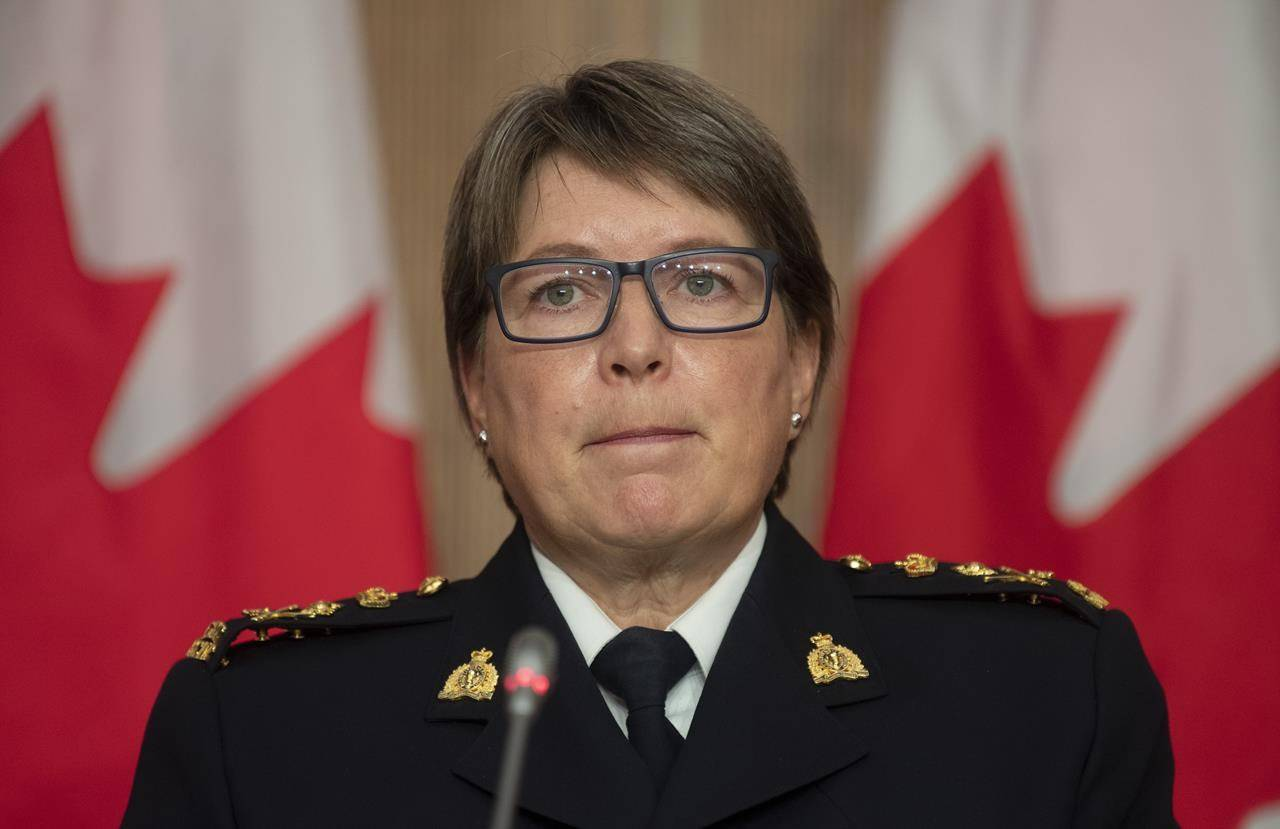 RCMP Commissioner Brenda Lucki listens to a question during a news conference in Ottawa, Wednesday October 21, 2020. THE CANADIAN PRESS/Adrian Wyld