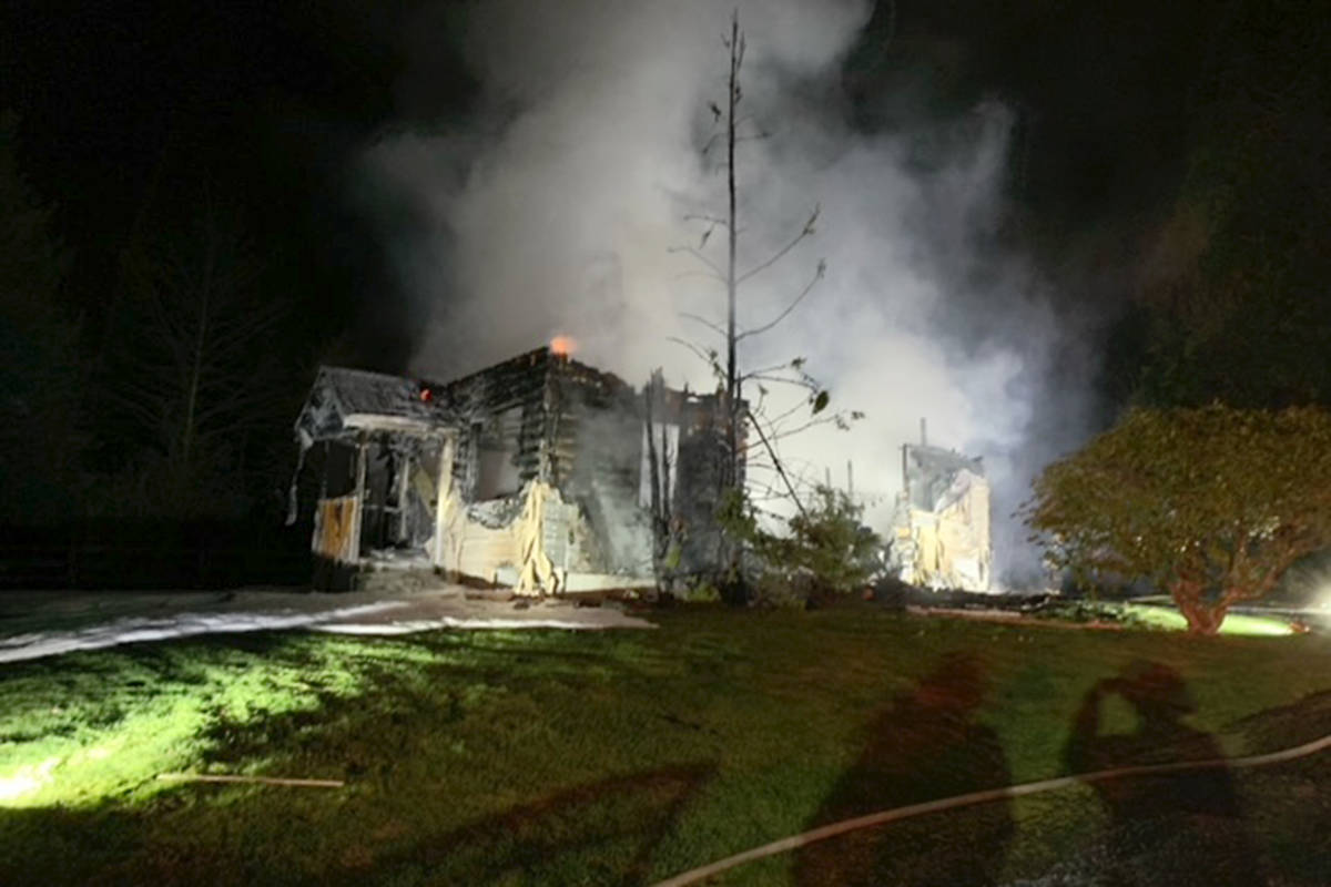 Crews were called to a house fire in Langley at 30th Avenue and 240th Street on Friday, April 2, 2021. It was reported around 3 a.m by a local firefighter who was driving to the scene of a motor vehicle crash. (Special to Langley Advance Times)