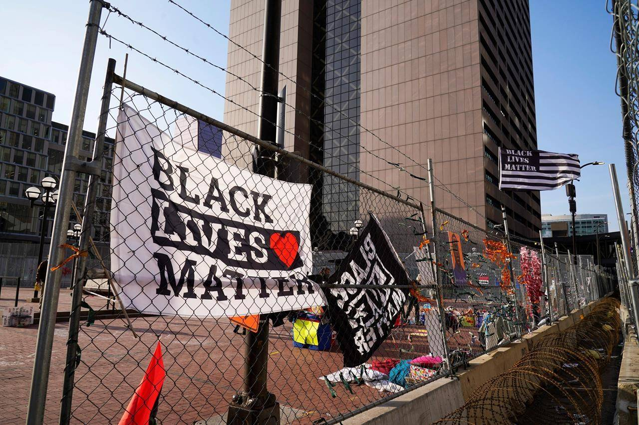 Black Lives Matter flags fly and line the fence surrounding the Hennepin County Government Center Friday, April 2, 2021 in Minneapolis where the trial for former Minneapolis police officer Derek Chauvin continues. Chauvin is charged with murder in the death of George Floyd during an arrest last May in Minneapolis. (AP Photo/Jim Mone)