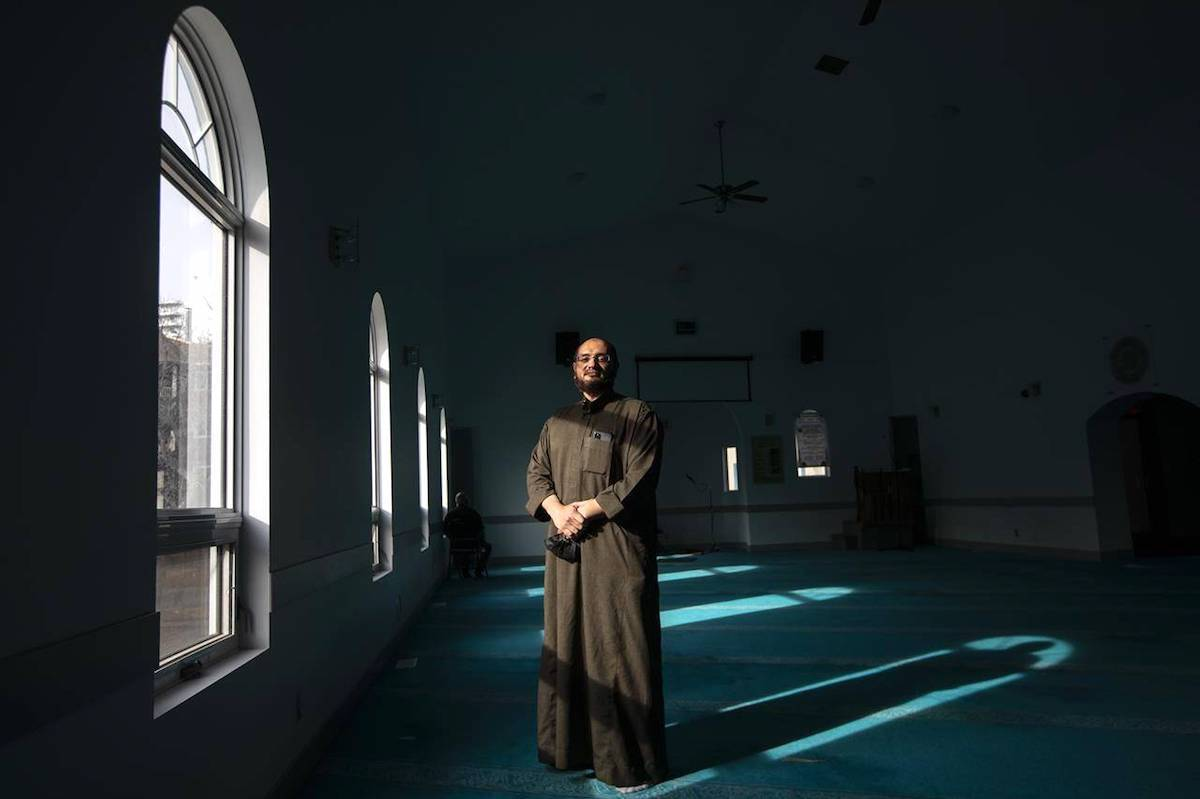 Vice-president of the Muslim Community of Edmonton Mosque Jamal Osman, front, and Imam Sherif El Sayed pose in Edmonton on Wednesday, March 31, 2021 (Jason Franson/The Canadian Press).