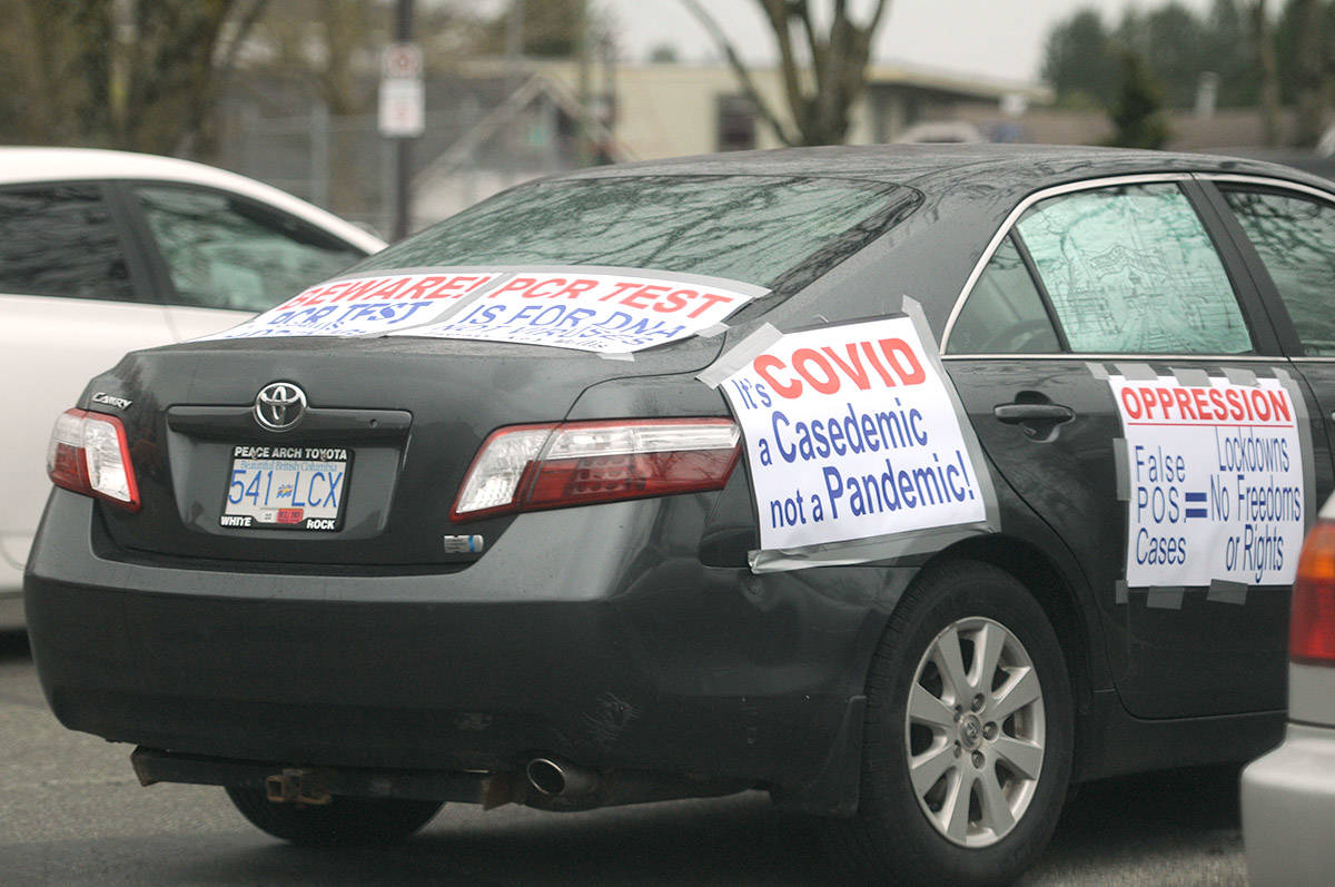 A car sits in a parking lot near Central Community Park during the Fraser Valley Freedom Rally on Saturday, April 3, 2021. (Jenna Hauck/ Chilliwack Progress)
