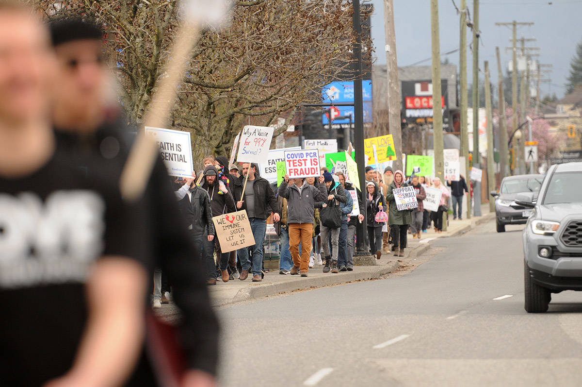 Hundreds of people march along Yale Road near Hodgins Avenue during the Fraser Valley Freedom Rally on Saturday, April 3, 2021. (Jenna Hauck/ Chilliwack Progress)