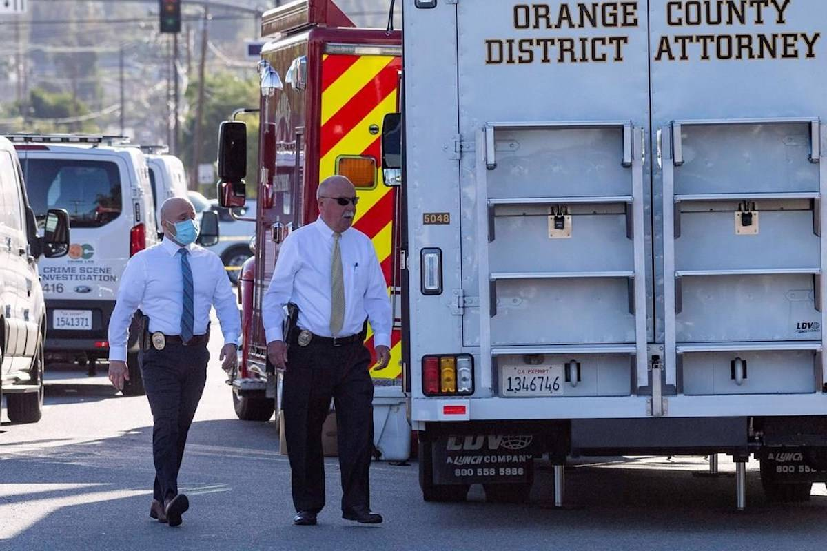 Officials work outside the scene of a shooting, Thursday, April 1, 2021 in Orange, Calif. The gunman who killed four people and wounded a fifth at an office complex knew all the victims either through business or personally, Southern California police said Thursday. (Paul Bersebach/The Orange County Register via AP)