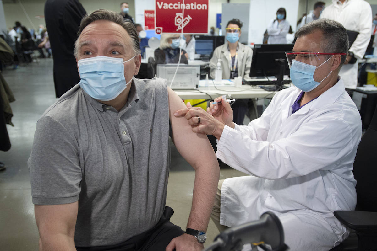 Quebec Premier Francois Legault receives his COVID-19 vaccination in Montreal, Friday, March 26, 2021. THE CANADIAN PRESS/Ryan Remiorz