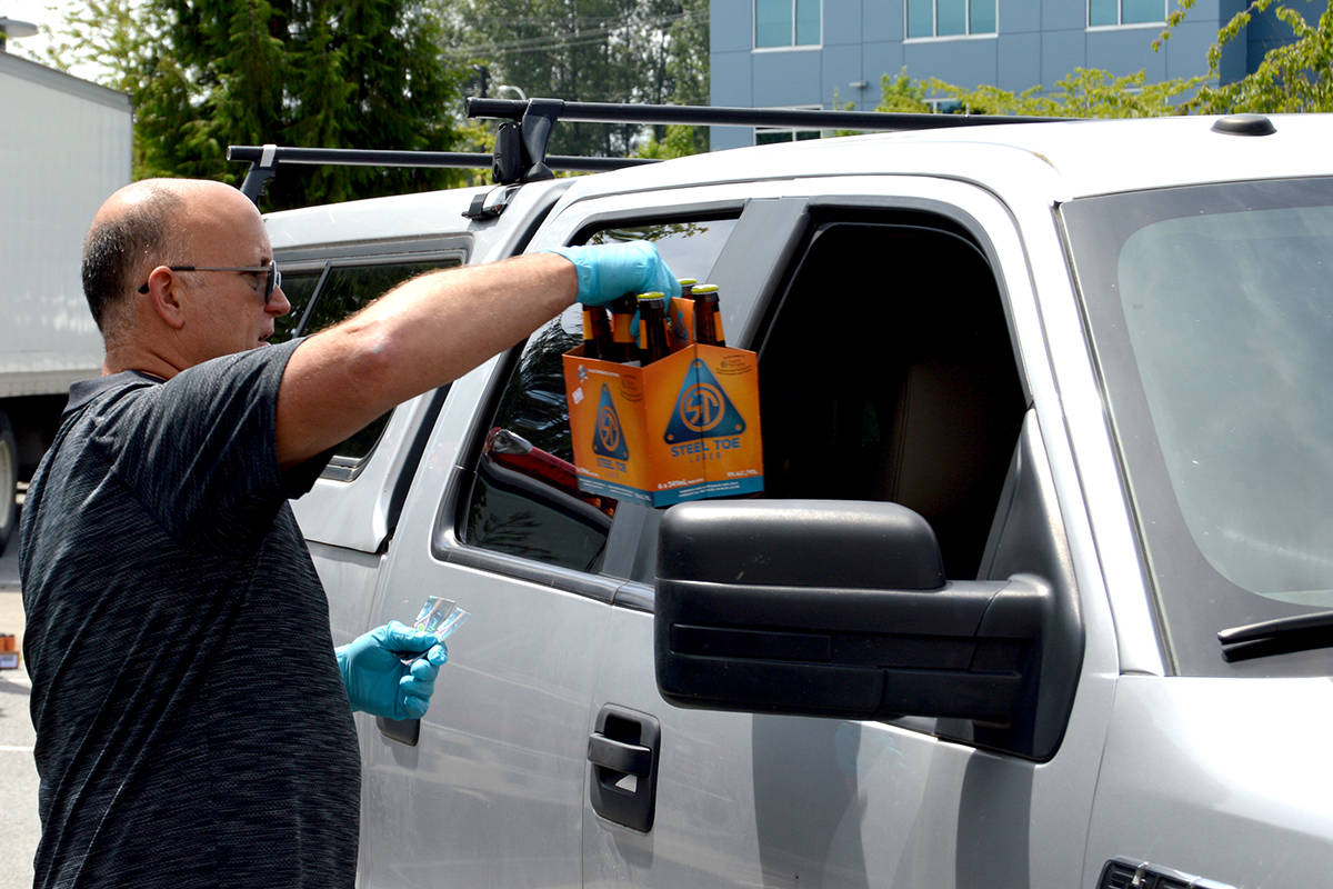 Dead Frog Brewery owner Derrick Smith at a giveaway to frontline workers last year. (Langley Advance Times files)