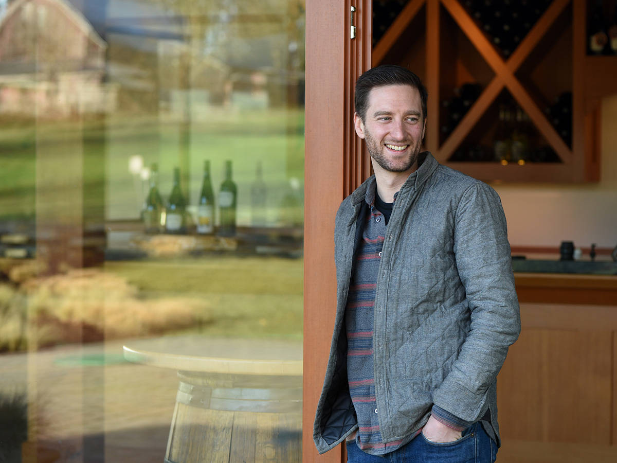 Chris Turyk, Marketing Director, stands outside the tasting room at Unsworth Vineyards. Don Denton photo