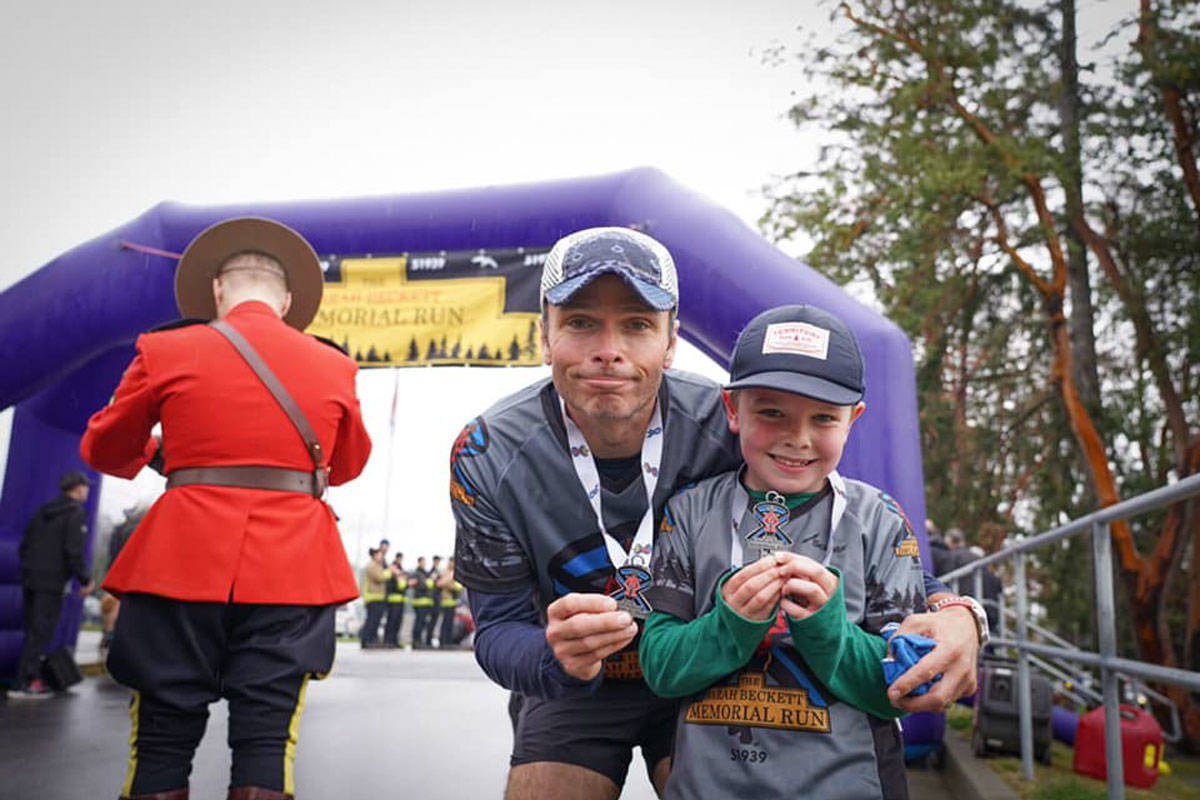 Scott Macausland and his son, Declan (7), at the finish line of the Sarah Beckett Memorial Run. (Black Press Media file photo)