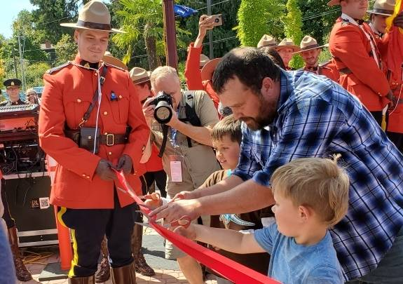 Sarah Beckett's widower Brad Aschenbrenner, and their sons open the memorial playground with an official ribbon cutting Aug. 24, 2019. (Black Press Media file photo)