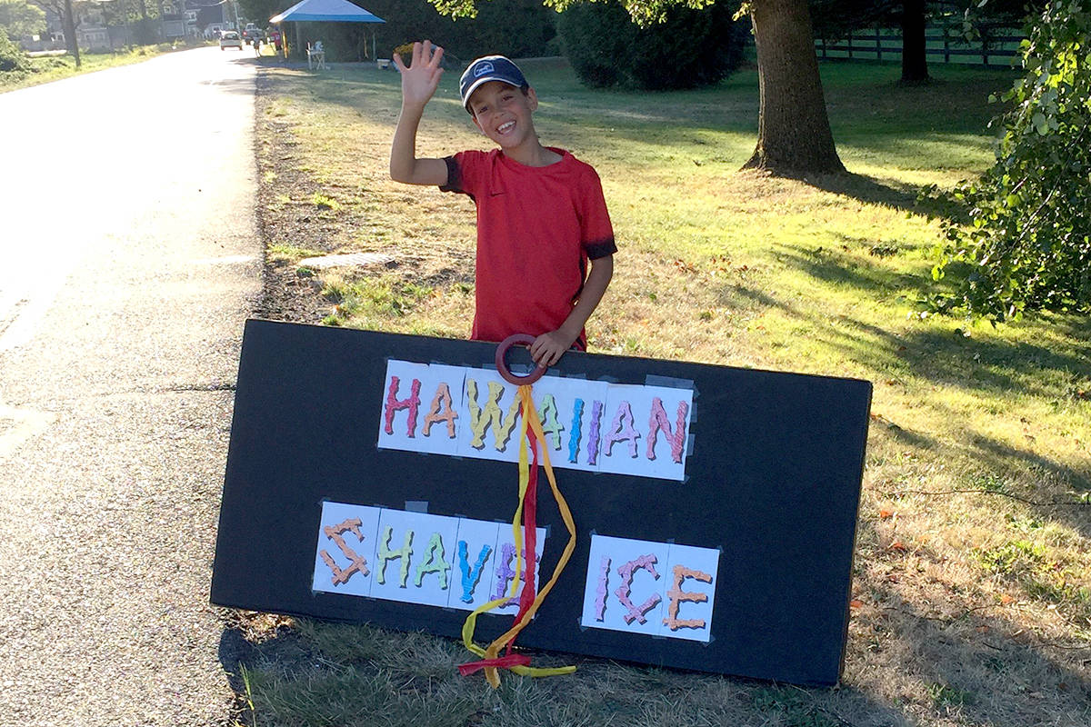 Jacob Springman put out colourful signs at their stand in rural Aldergrove when it's open. (Special to The Star)