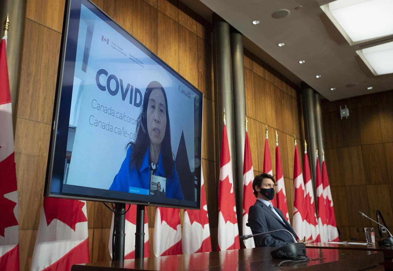 Prime Minister Justin Trudeau looks on as Chief Public Health Officer Theresa Tam appears via videoconference at a news conference on the COVID-19 pandemic, Tuesday April 6, 2021, in Ottawa. THE CANADIAN PRESS/Adrian Wyld