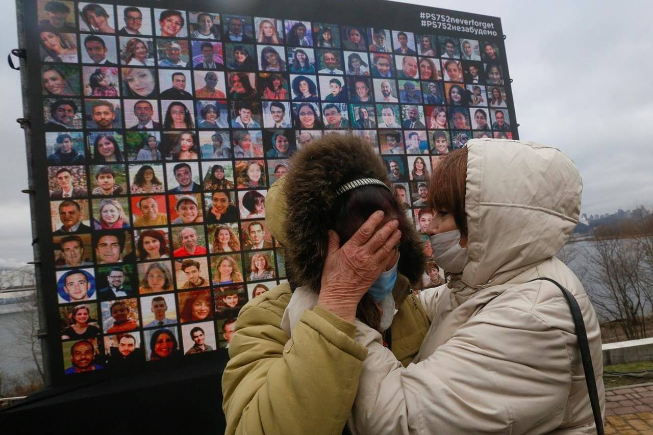 Relatives react at a memorial in Kyiv, Ukraine, Friday, Jan. 8, 2021, for the victims of a Ukrainian 737-800 plane crash on the outskirts of Tehran.Ten officials have been indicted in Iran over the 2020 military shootdown of a Ukrainian passenger plane that killed 176 people, but the move did nothing to quell Canadian demands for accountability Tuesday. THE CANADIAN PRESS/AP/Efrem Lukatsky