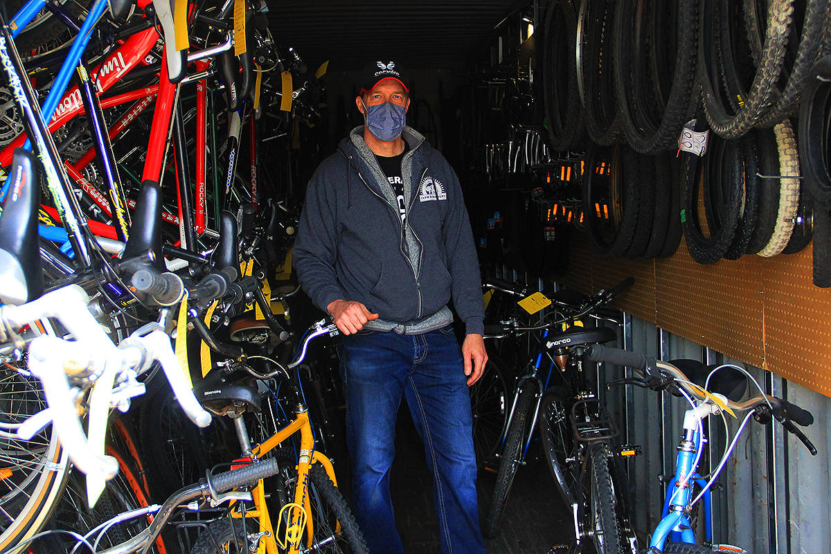 Joe Viel, manager of Cloverdale Community Cycles, stands among some of the bikes that will be up for grabs April 10. The cycle shop is located directly behind Pacific Community Church at 5337 180 Street. (Photo: Malin Jordan)