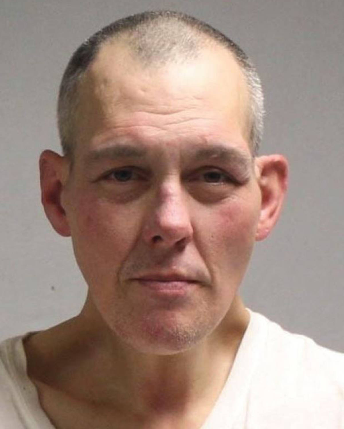 Yves Castonguay, 47, is wanted on hate crime and mischief charges in connection to vandalism at the Chinese Cultural Centre in April 2020. (Vancouver Police Department)