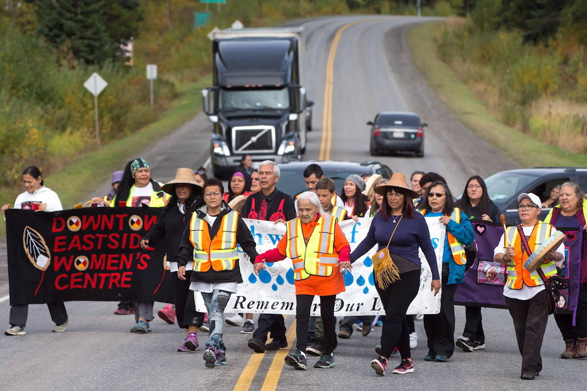 Mabel Todd, 83, of the Nak'azdli First Nation, leads a group of family members and advocates of missing and murdered Indigenous women and girls as they walk along the so-called Highway of Tears in Moricetown, B.C. THE CANADIAN PRESS/Darryl Dyck