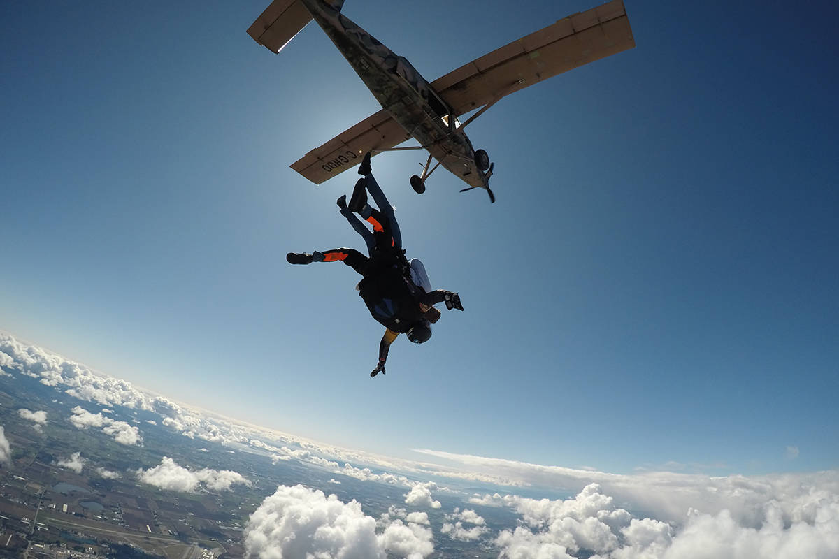"Scott Cave and Lucky free falling after leaping from an airplane at 10,000 feet. Cave says the stories you hear in drop zones can be very personal. Taylor ""Moose"" Cividino photo, courtesy of Skydive Vancouver."