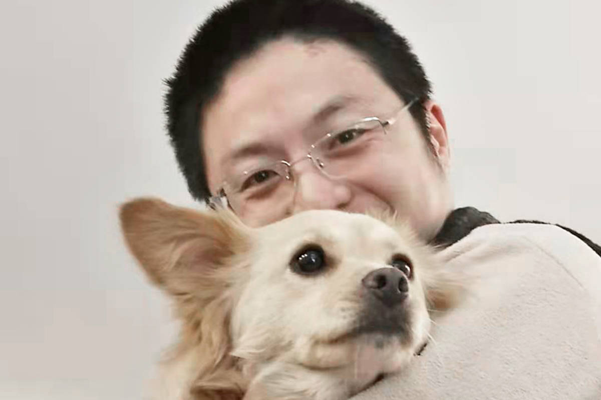 Ruming Jiang and his dog Chiu Chiu are doing fine following a brush with hypothermia that saw several people work together to get them out of the Fraser River near Langley's Derby Reach Park (Special to Langley Advance Times)