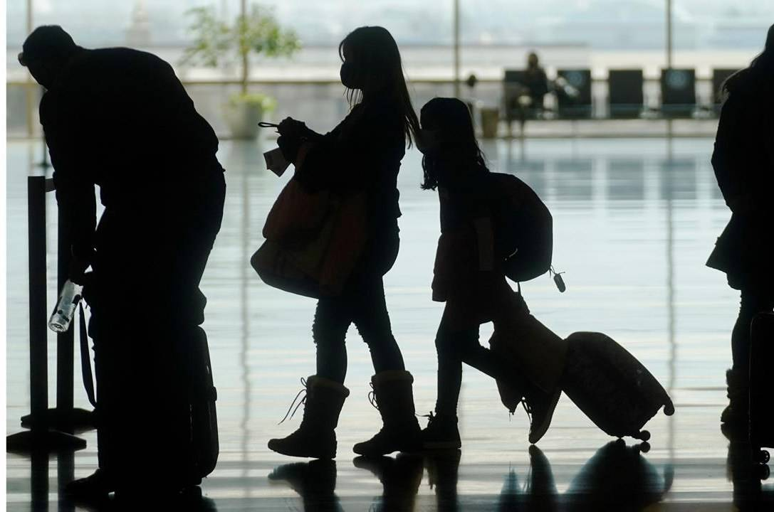 Travelers walk through the Salt Lake City International Airport Wednesday, March 17, 2021, in Salt Lake City. THE CANADIAN PRESS/AP, Rick Bowmer