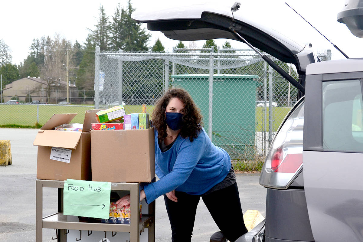 Sarah Mast halls food into Parkside, donated through the Zoe Leadership Program at Living Waters Church. (Ryan Uytdewilligen/Aldergrove Star)