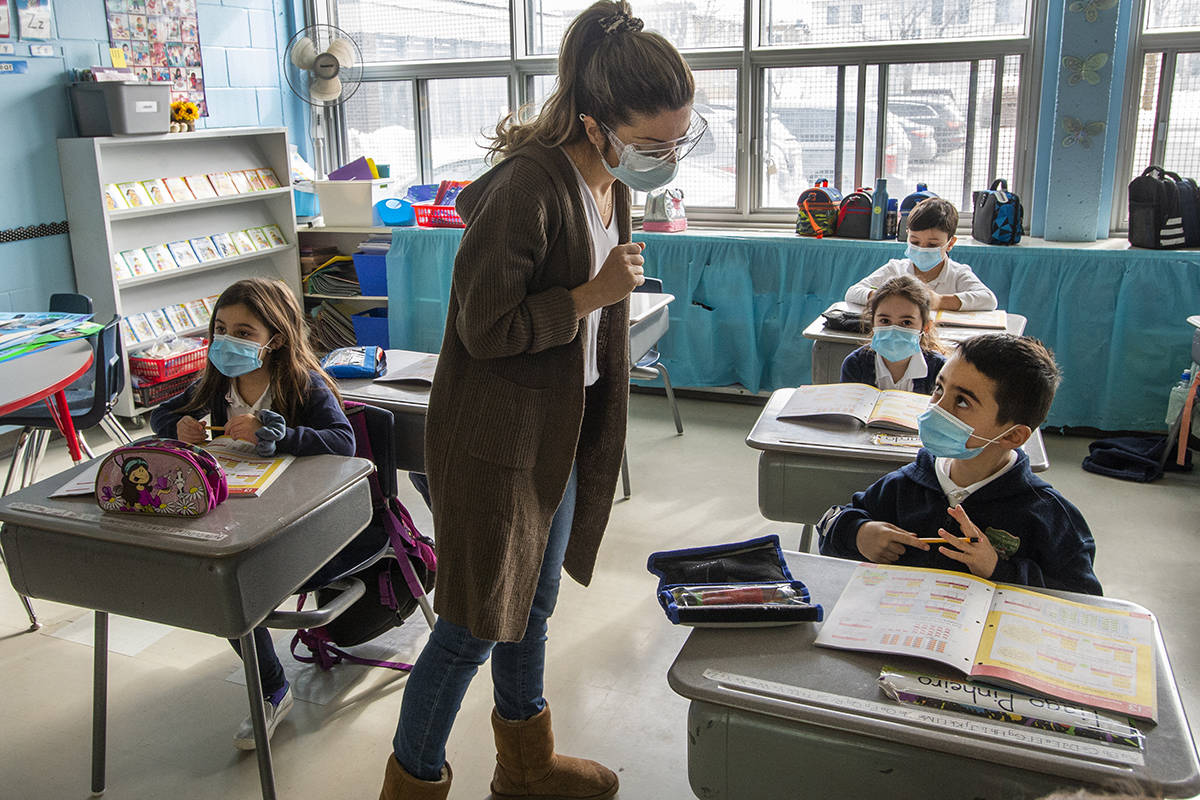 Teacher Elisa Infusini and her grade one students wear masks as they attend class at Honore Mercier elementary school, Tuesday, March 9, 2021 in Montreal.THE CANADIAN PRESS/Ryan Remiorz