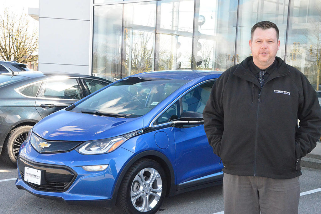 Keith Gibson of Preston GM with a Chevrolet Bolt. Electric cars made up almost 10 per cent of new light vehicle sales in B.C. last year, the government says. (Matthew Claxton/Langley Advance Times)