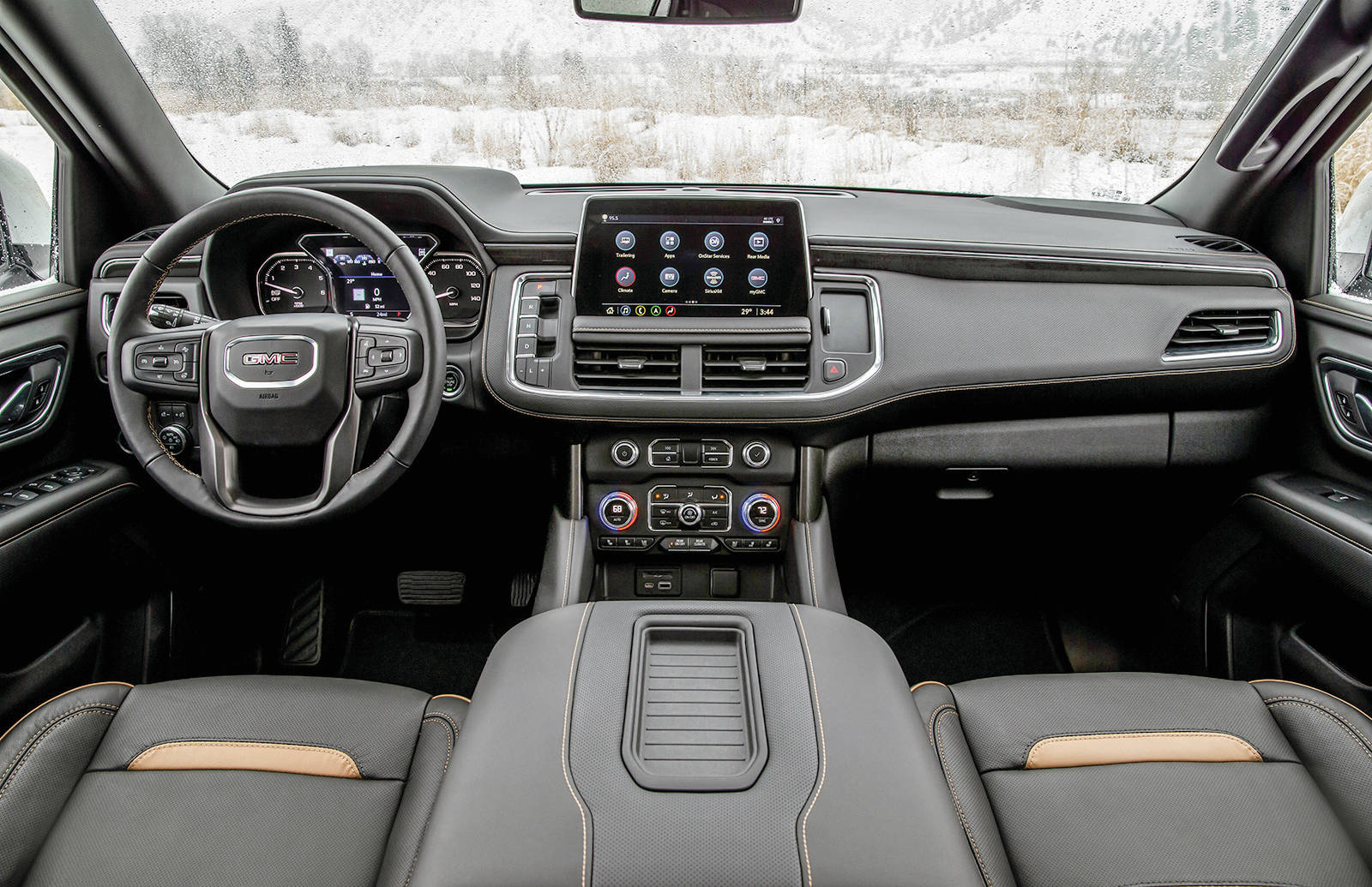 The Yukon's interior-design progress from one generation to the next is dramatic. It would be more unified if GMC cut down the number of fonts it uses on the various dials, switches and displays. Check out that wide console. PHOTO: GENERAL MOTORS