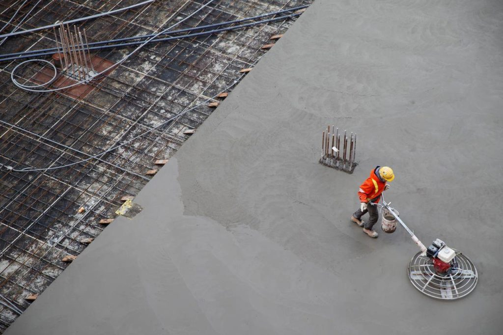 A worker smooths concrete at a construction site in Toronto on January 16, 2020. THE CANADIAN PRESS/Cole Burston