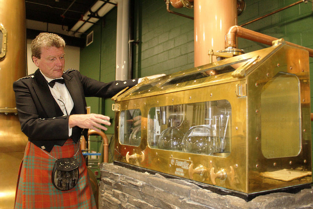Graeme Macaloney, whisky maker and owner of MacMhaol-onfhaidh (Macaloney) Brewers & Distillers Ltd. in Saanich, is facing a court challenge as the Scotch Whisky Association and a Glasgow distillery oppose the company's use of various terms they claim insinuate the spirits were made in Scotland. (Black Press Media file photo)