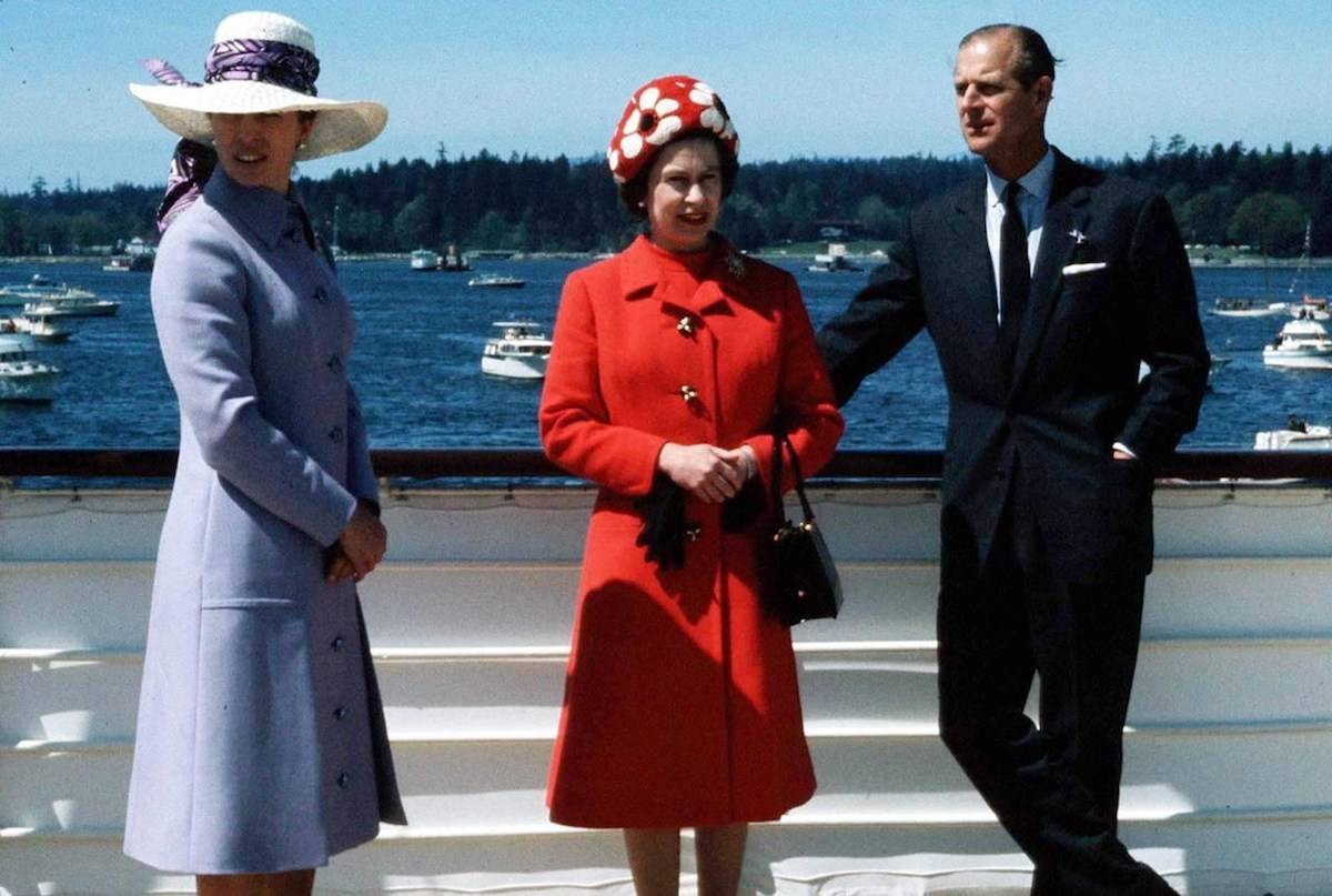 The Queen, centre, Prince Philip, right, and Princess Anne relax as they sail to Victoria, B.C., on May 3, 1971 accompanied out of Vancouver harbour by numerous small craft. THE CANADIAN PRESS/Bill Croke