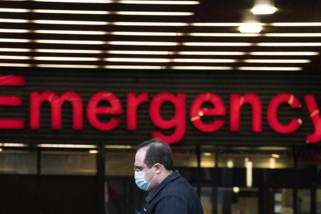 A man wears a face mask past the emergency department of the Vancouver General Hospital. (THE CANADIAN PRESS/Jonathan Hayward)
