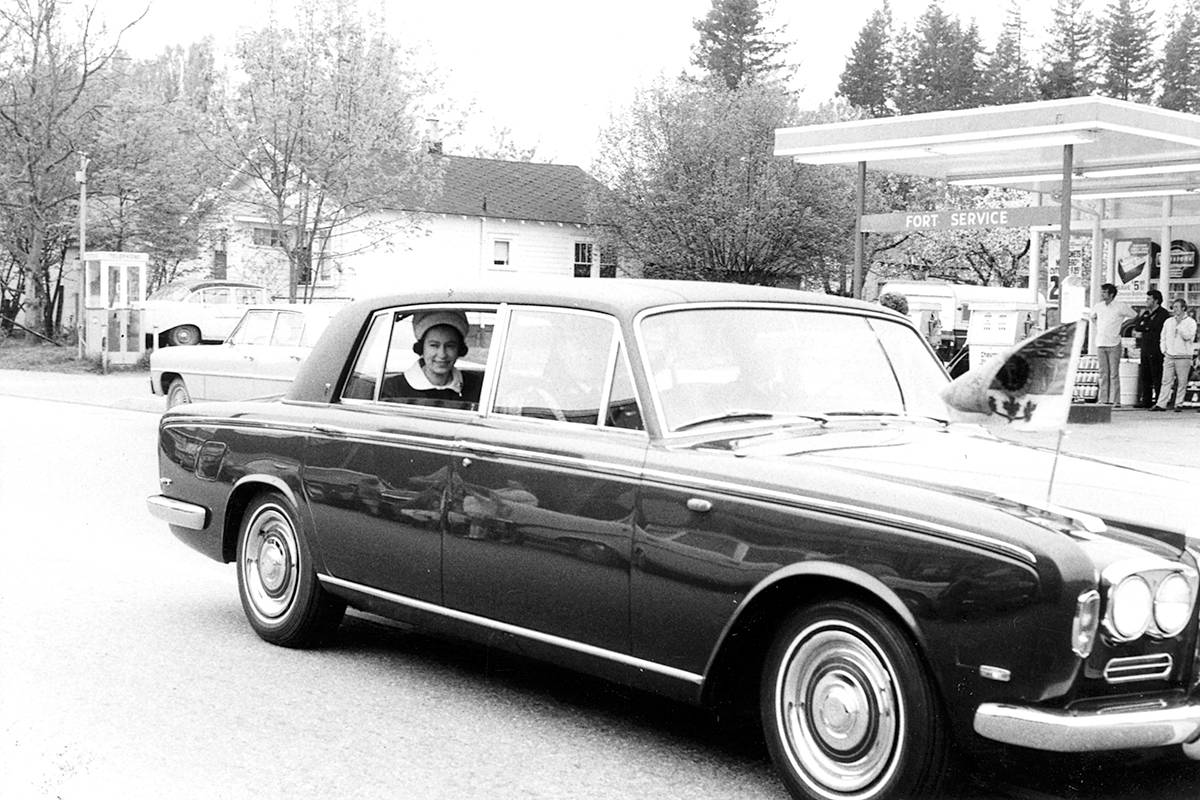 Queen Elizabeth, hubby Prince Philip, and daughter Princess Anne visited Fort Langley on May 8, 1971 as part of a BC centennial celebration. The procession is seen driving down Glover Road, through the village. (Langley Centennial Museum archives/Special to Langley Advance Times)