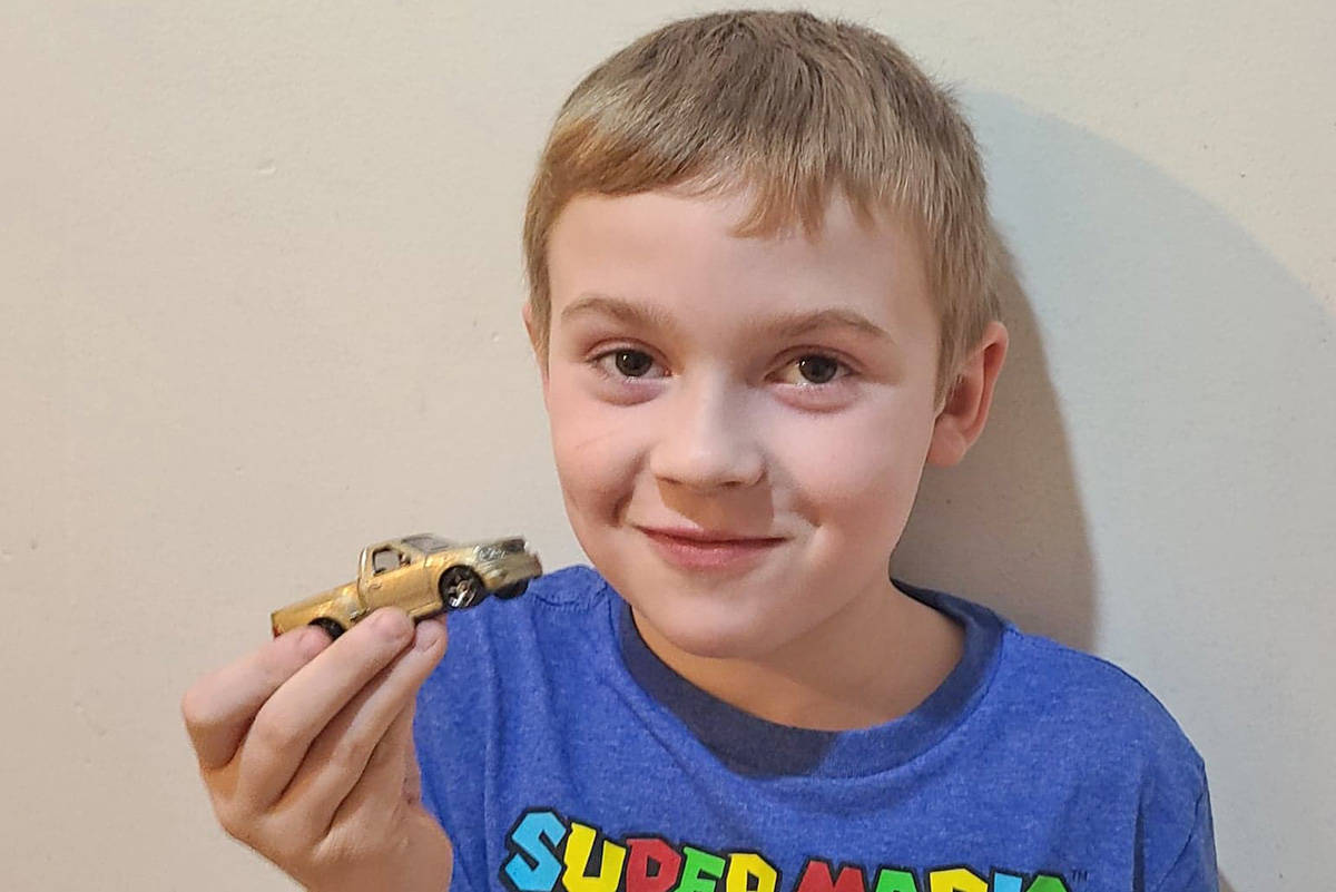 Tyson Ginter, 7, is proud of his latest Hot Wheels he recently received by Quesnel RCMP Const. Matt Joyce. (Photo submitted)