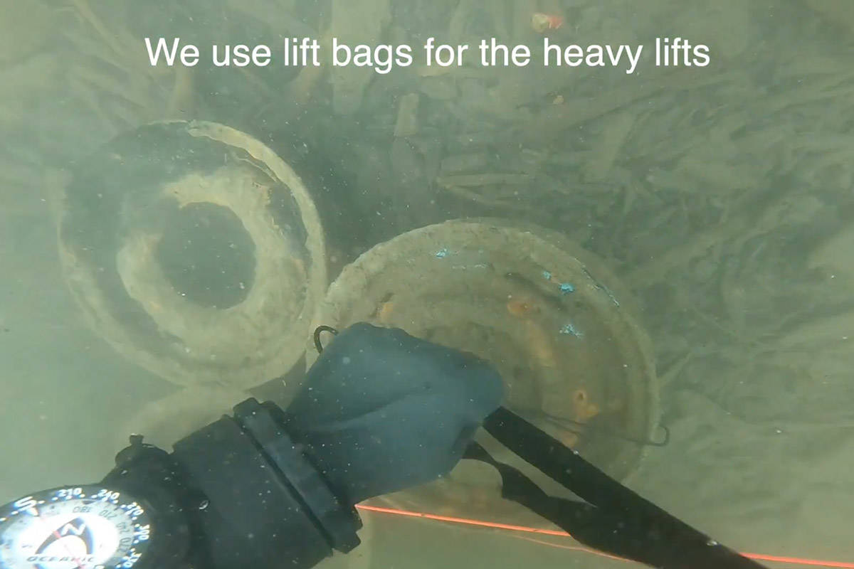 These car rims that were removed from Cultus Lake was part of the 470 pounds of trash four members with Divers for Cleaner Lakes and Oceans hauled out March 28 and 29, 2021. (YouTube/Henry Wang)