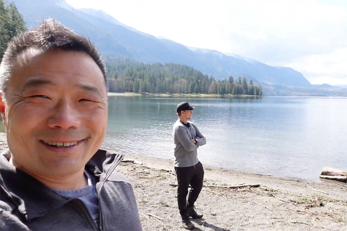 Henry Wang (left) was one of four members with Divers for Cleaner Lakes and Oceans who was out at Cultus Lake on March 28 and 29 hauling trash out of the waters. (YouTube/Henry Wang)