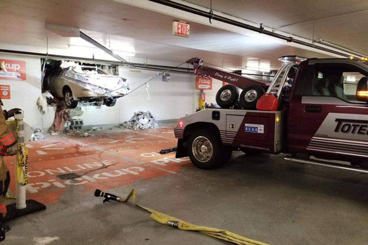 A vehicle that was driven through the wall of a parkade at Uptown Shopping Centre and into the nearby Walmart on April 9 was removed through another hole in the wall later that night. (Photo via Saanich Police Department and Ayush Kakkar)