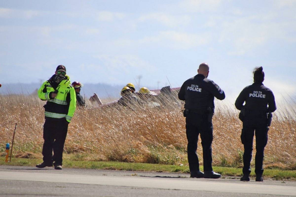 Emergency crews on scene after a small plane crashed in a grassy area on the northeast side of Boundary Bay Airport Saturday morning (April 10). A freelancer said the plane caught fire and one person was transported to hospital by BC Emergency Health Services. (Photo: Shane MacKichan)