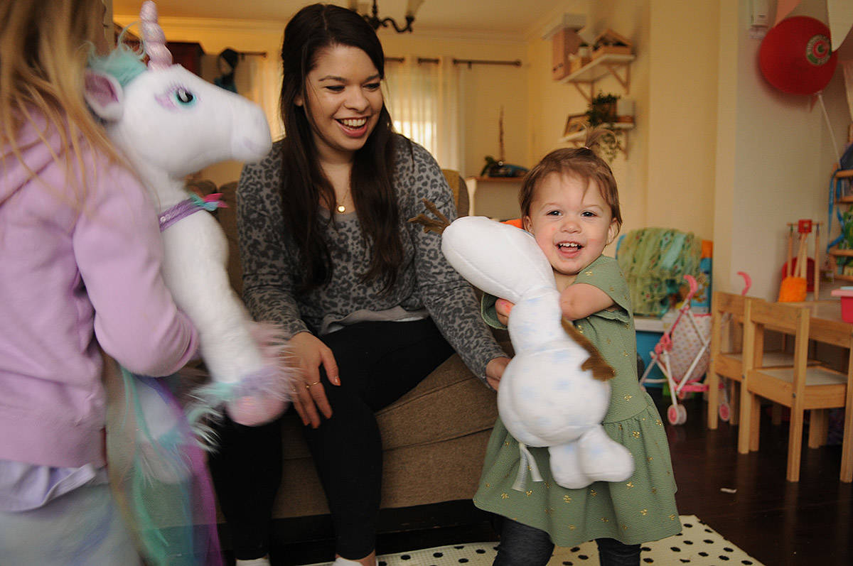 Two-year-old Ivy McLeod, seen here on April 9, 2021 with four-year-old sister Elena (left) and mom Vanessa, was born with limb differences. The family, including husband/dad Sean McLeod, is looking for a family puppy that also has a limb difference. (Jenna Hauck/ Chilliwack Progress)