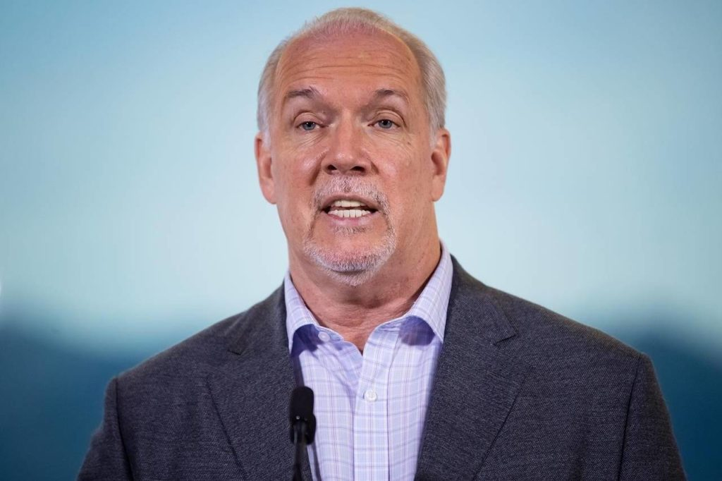 B.C. Premier John Horgan responds to questions during a postelection news conference in Vancouver, on Sunday, October 25, 2020. British Columbia's opposition Liberals and Greens acknowledge the COVID-19 pandemic has presented huge challenges for Horgan's government, but they say Monday's throne speech must outline a coherent plan for the province's economic, health, social and environmental future. THE CANADIAN PRESS/Darryl Dyck
