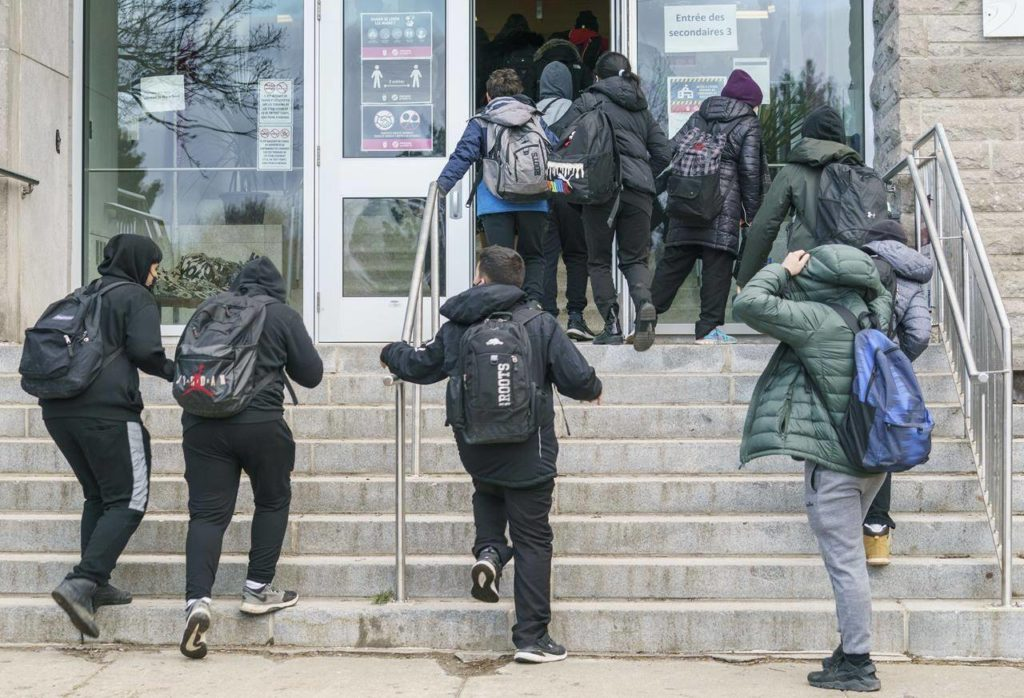 Students enter the Pierre Laporte Secondary School as secondary school students return to class full time during the COVID-19 pandemic in Montreal, Monday, March 29, 2021. Pandemic-fuelled frustration has some teens expressing anger in unhealthy ways after a year of missed social connections that would typically help them mature and regulate their emotions, says a psychiatrist calling for more education on coping skills as part of the school curriculum. THE CANADIAN PRESS/Paul Chiasson