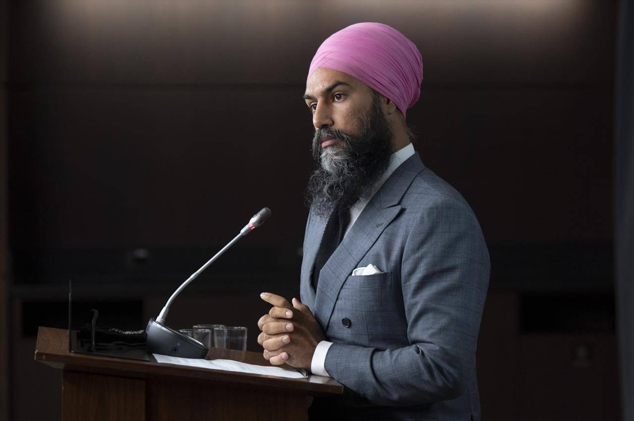 NDP Leader Jagmeet Singh listens to a question during a news conference in Ottawa, Tuesday, Sept. 15, 2020. Thousands of federal New Democrats will gather online Friday afternoon to kick off a three-day policy convention that has already exposed some internal party divisions. THE CANADIAN PRESS/Adrian Wyld