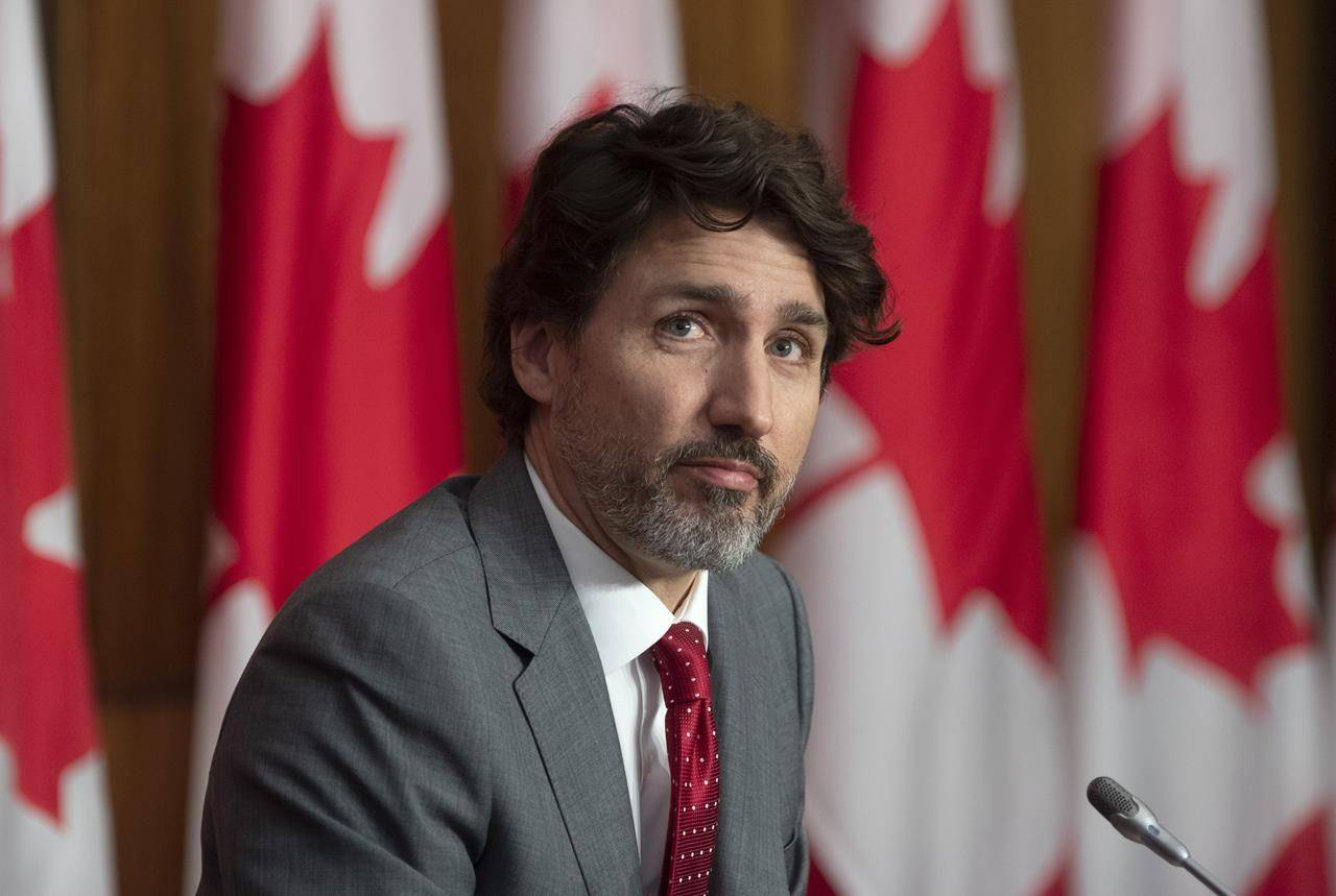 Prime Minister Justin Trudeau watches a speaker appear by videoconference during a news conference in Ottawa, Friday, April 9, 2021. Grassroots Liberals have overwhelmingly endorsed a resolution calling on the federal government to develop and implement a universal basic income — despite Prime Minister Justin Trudeau's apparent lack of enthusiasm for the idea. THE CANADIAN PRESS/Adrian Wyld