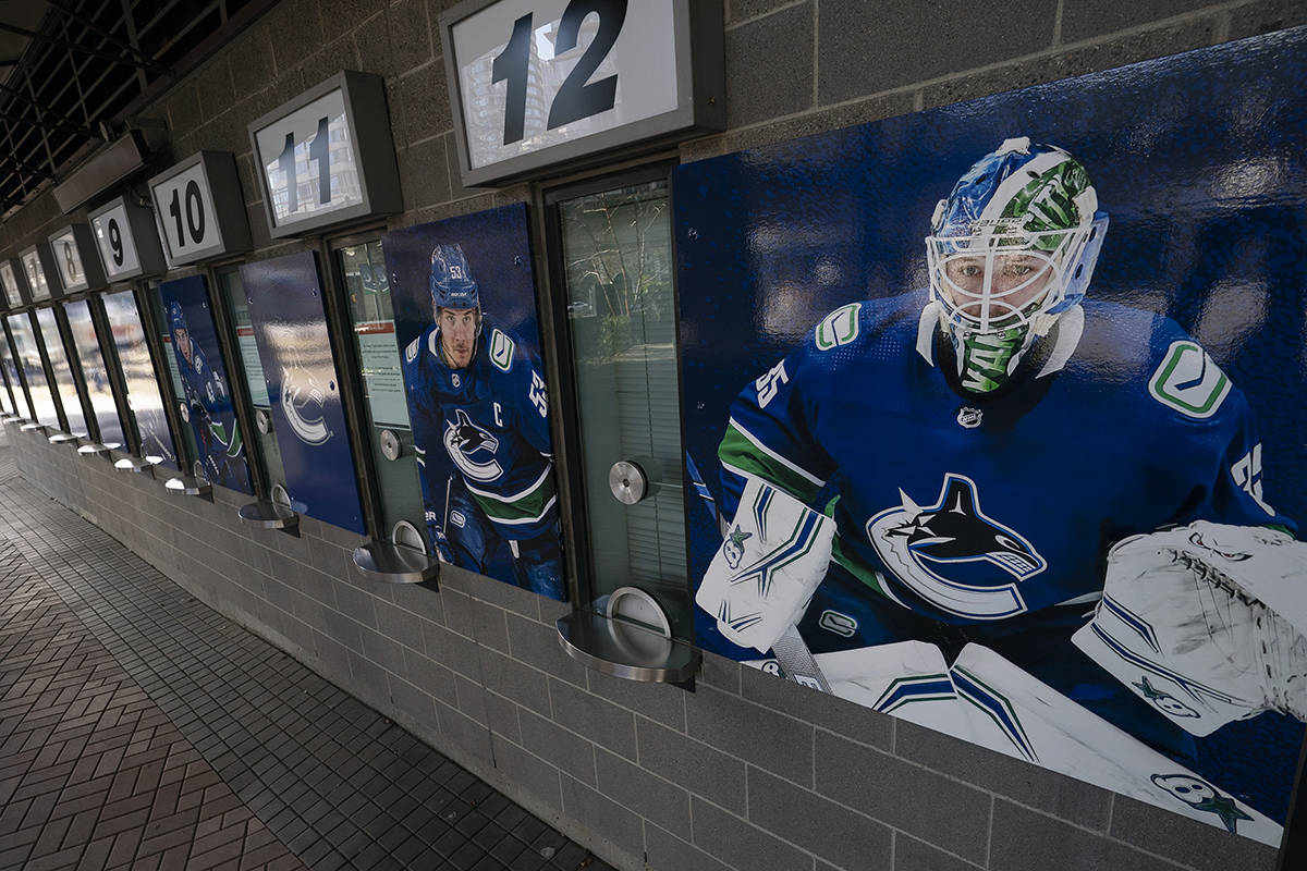 Photos of Vancouver Canucks players are pictured outside the closed box office of Rogers Arena in downtown Vancouver Thursday, April 8, 2021. The Vancouver Canucks say 25 players and coaches have tested positive during a COVID-19 outbreak that involves a variant of the virus. It is now the biggest reported outbreak in the NHL this season. THE CANADIAN PRESS/Jonathan Hayward