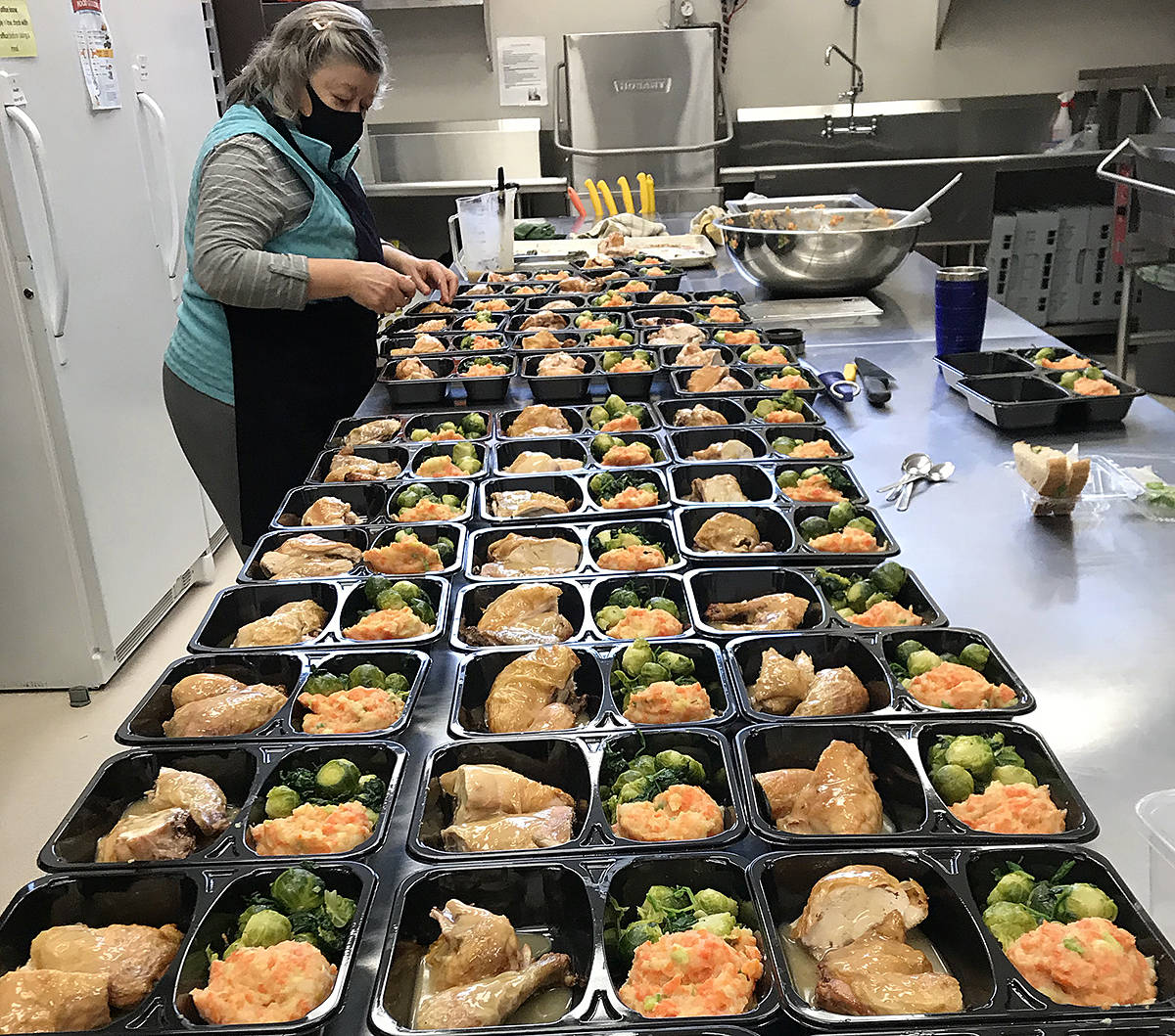 There are currently four volunteers running the Community Kitchen program for Langley Meals on Wheels - working twice a week in a local church kitchen to make frozen meals for people in need in the community. Organizer Lesley Wells is looking at adding a third shift, and currently looking for volunteers. (Special to Langley Advance Times)