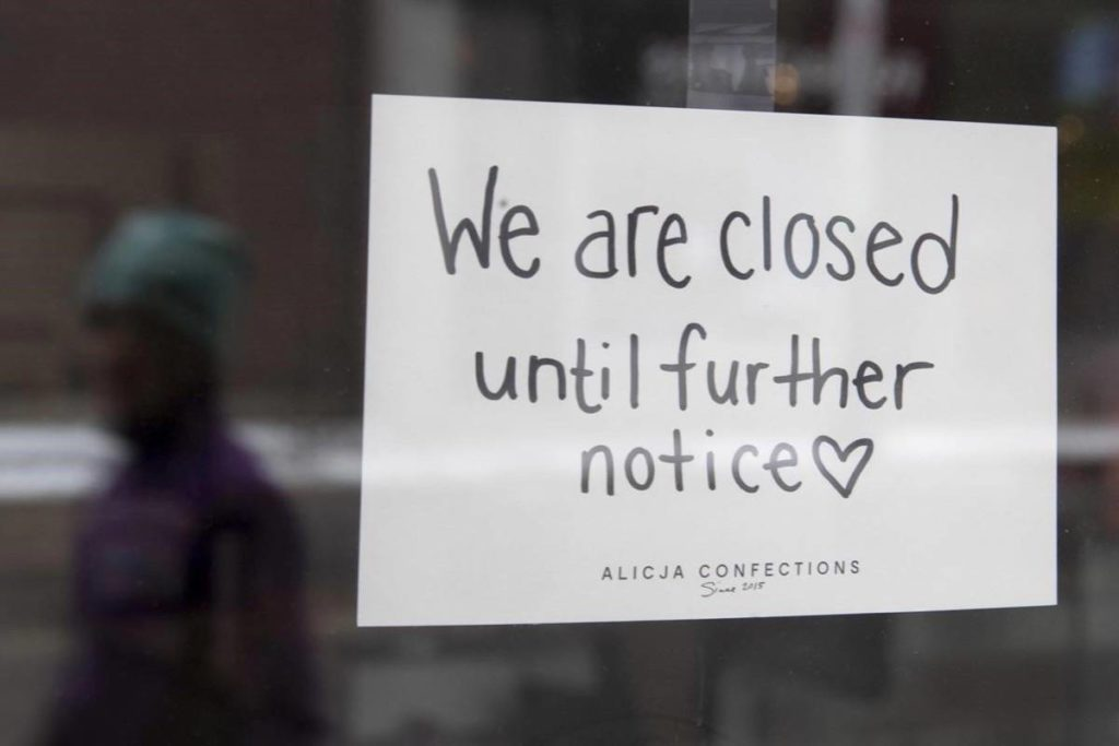 A sign on a shop window indicates the store is closed in Ottawa, Monday March 23, 2020. The Canadian Federation of Independent Business is raising its estimate for the number of businesses that are considering the possibility of closing permanently. THE CANADIAN PRESS/Adrian Wyld