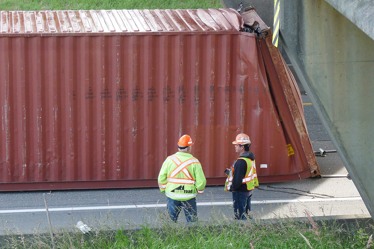 A cargo container was knocked off a truck trying to pass under the Glover Road overpass in 2018. Crews will be working on the overpass Monday, April 12 in the evening and one eastbound lane will be temporarily closed. (Langley Advance Times files)
