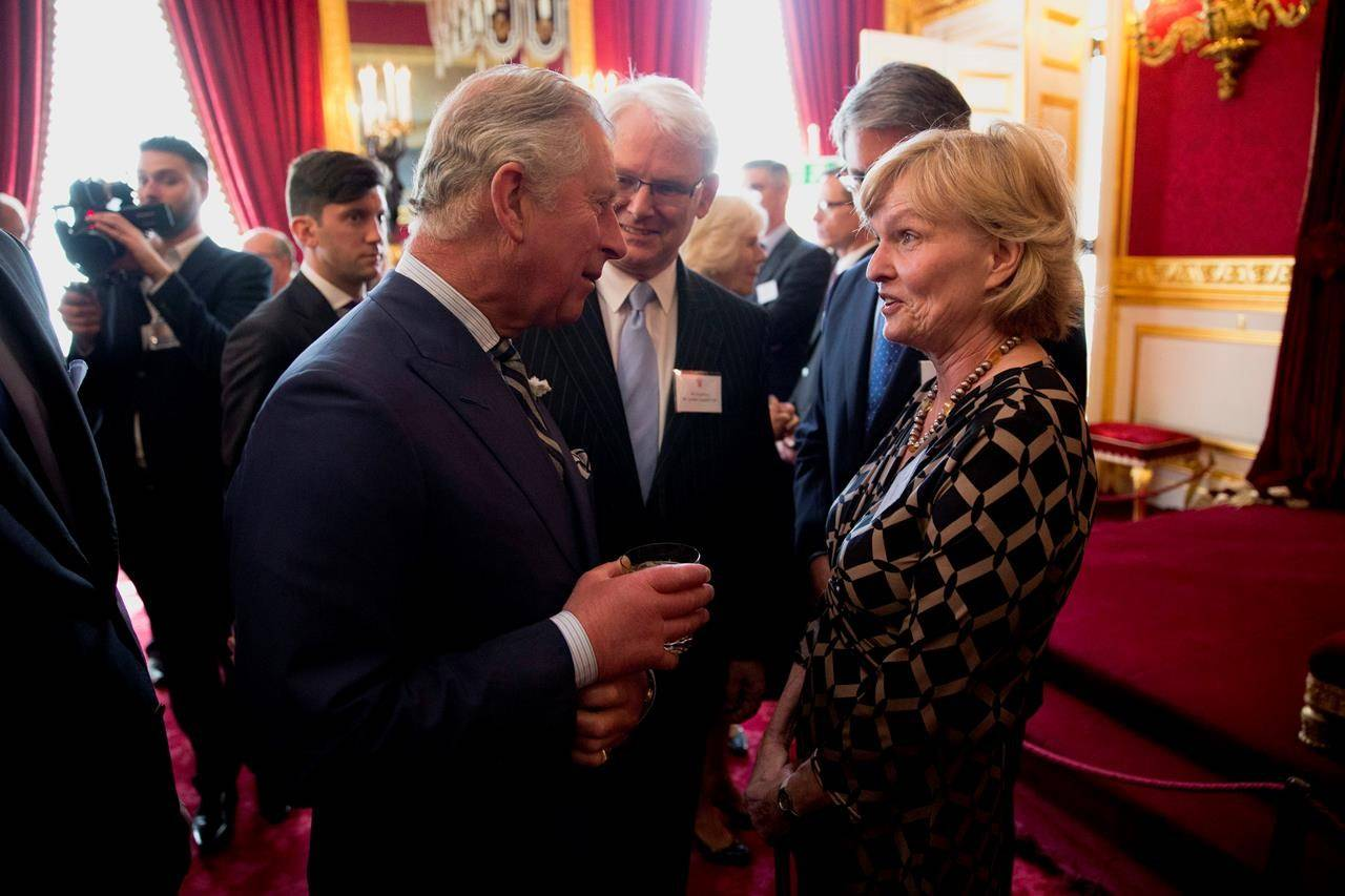 """FILE - In this file photo dated Wednesday, May 14, 2014, Britain's Prince Charles talks with Canadian author and Oxford University professor Margaret MacMillan, right, during a reception for Canadians living and working in the UK at St James's Palace in London. Prince Philip who died Friday April 9, 2021, aged 99, lived through a tumultuous century of war and upheavals, but he helped forge a period of stability for the British monarchy under his wife, Queen Elizabeth II. Historian Margaret MacMillan says """"Philip's life bookends that great moment of transition at the end of the First World War"""" and another major moment of transition today.(AP Photo/Matt Dunham, FILE)"""