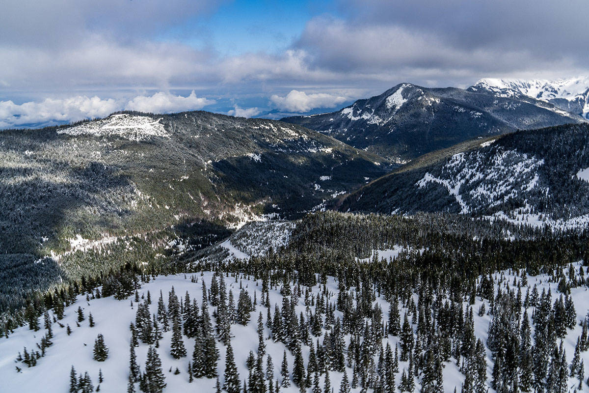 Looking north at Mt. Archibald (centre right), Chipmunk Ridge on the left, with the potential Alpine Village site located in the notch just before Mt. Archibald.