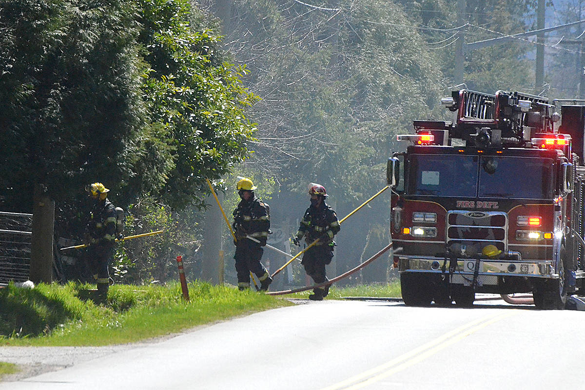 Firefighters entered a property on 208th Street to fight a fire on Tuesday, April 13. (Matthew Claxton/Langley Advance Times)